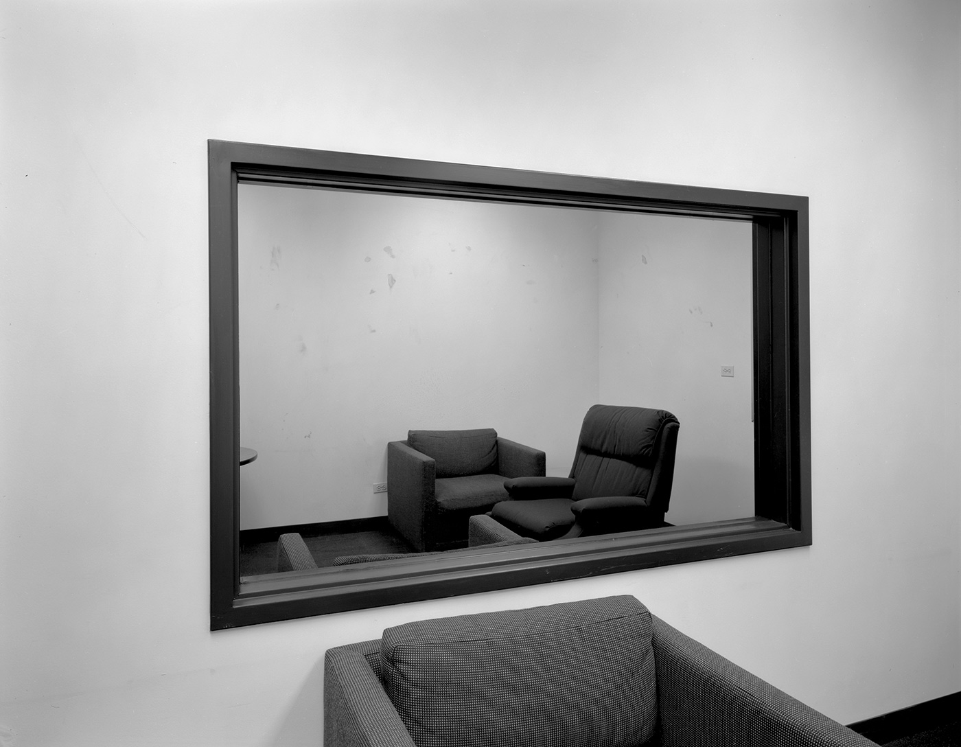 Lynne Cohen / Estate  - Untitled (observation room with two-way mirror), 1980-1989
