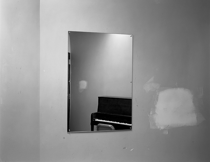 Lynne Cohen / Estate  - Untitled (mirror with piano and smudge), 1980-1989