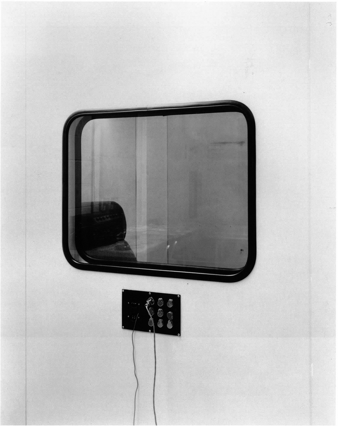 Lynne Cohen / Estate  - Untitled (acoustic window with chair), 1980's